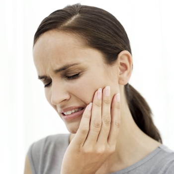 woman with TMJ needs dental coverage