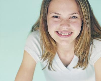 Girl With Braces and Dental Insurance